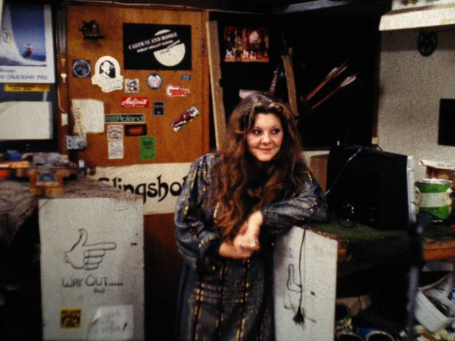 Judy Parkinson after rehearsals in Romney's workshop 1982. On the wall behind can be seen my 18ft Skiff 1982 calendar dating the photo. Judy was the singer in 'Parking Zone'