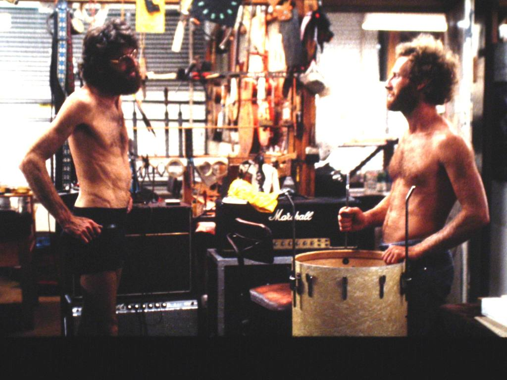 Romney Godden and drummer Geoff Parsons in Romney's workshop 1982