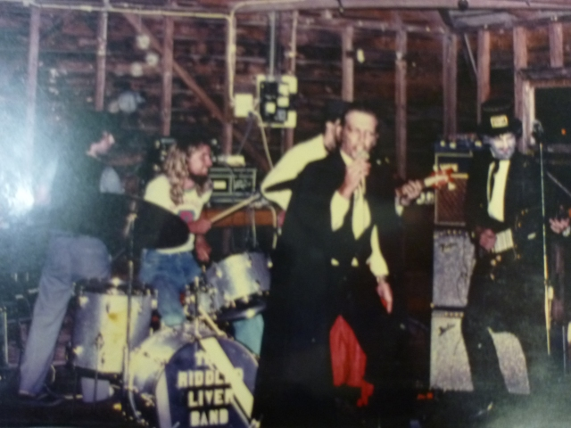 Billy Jackson on vocals and cape out front of the 'Riddled Liver Band'