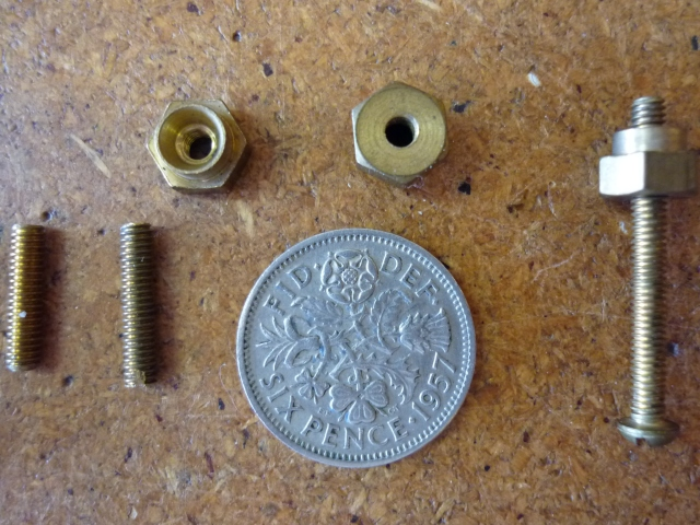 "Another closeup of 6BA screws and cup nuts. Threaded 7/16"" section at left is similar to what Brian used for the posts which were screwed into the body, soldered at the top end and had the pickup wires soldered to them"