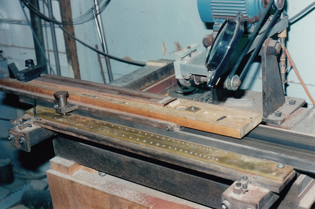 Brazilian rosewood fingerboard being slotted at Chris Kinman's workshop