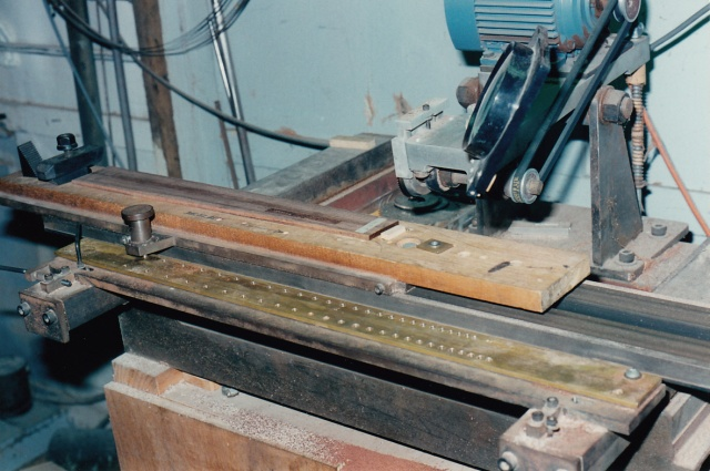 Brazilian rosewood fingerboard being slotted at Chris Kinman's workshop