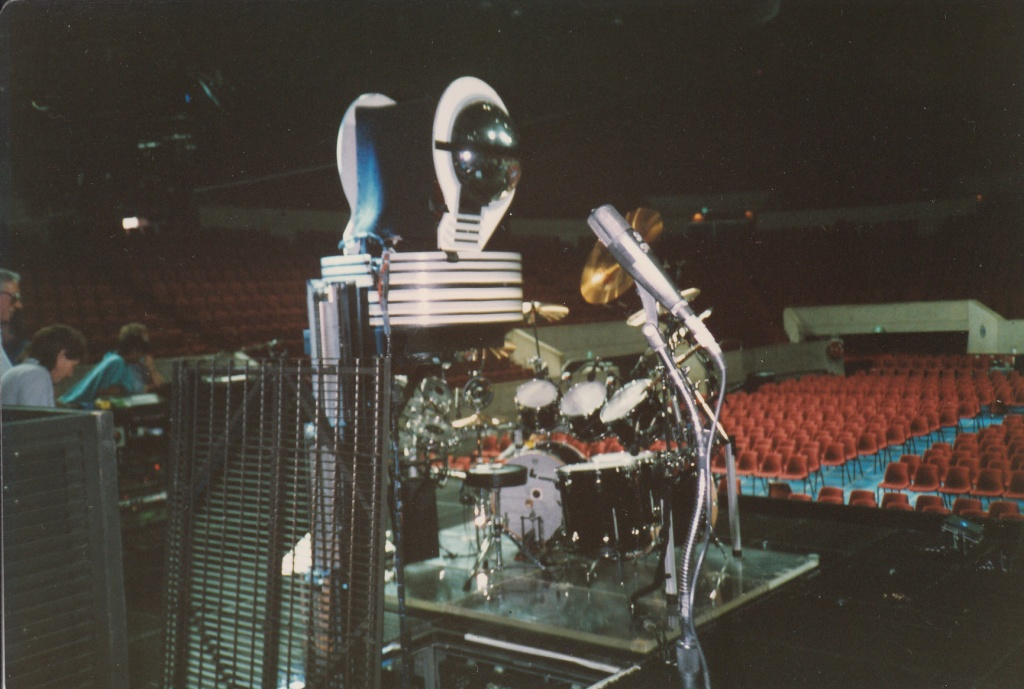 Nick's drums and the triffid which emerges behind him